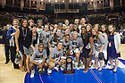 Mar. 31, 2014; The Notre Dame Fighting Irish pose with the trophy after defeating the Baylor Bears in the finals of the Notre Dame regional in the 2014 NCAA Tournament at the Purcell Pavilion. Notre Dame won 88-69. Photo by Barbara Johnston/University of Notre Dame