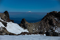 Standing in the crater from the 1915 eruption of Lassen Peak, Mt. Shasta is visible more than one hundred miles away.
