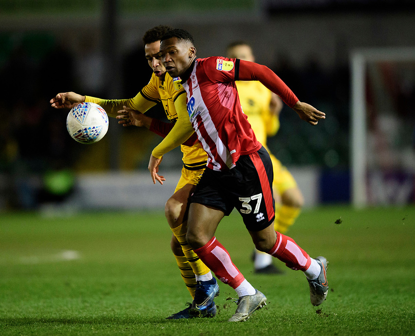 Lincoln City's Tayo Edun vies for possession with Milton Keynes Dons' Sam Nombe<br /> <br /> Photographer Chris Vaughan/CameraSport<br /> <br /> The EFL Sky Bet League One - Lincoln City v Milton Keynes Dons - Tuesday 11th February 2020 - LNER Stadium - Lincoln<br /> <br /> World Copyright © 2020 CameraSport. All rights reserved. 43 Linden Ave. Countesthorpe. Leicester. England. LE8 5PG - Tel: +44 (0) 116 277 4147 - admin@camerasport.com - www.camerasport.com