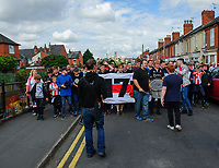 Lincoln City fans arrive at the ground as the complete a celebratory march ahead of the Imps' first game at Sincil Bank back in the Football League<br /> <br /> Photographer Chris Vaughan/CameraSport<br /> <br /> The EFL Sky Bet League Two - Lincoln City v Morecambe - Saturday August 12th 2017 - Sincil Bank - Lincoln<br /> <br /> World Copyright &copy; 2017 CameraSport. All rights reserved. 43 Linden Ave. Countesthorpe. Leicester. England. LE8 5PG - Tel: +44 (0) 116 277 4147 - admin@camerasport.com - www.camerasport.com