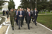 Romanian Minister of Defense Ioan Mircea Pascu (center) escorts United States Secretary of Defense Donald H. Rumsfeld (front right) and military officials on a tour of Mihail Kogalniceanu Air Base in Constanta, Romania, on October 11, 2004. <br /> Mandatory Credit: James M. Bowman / DoD via CNP