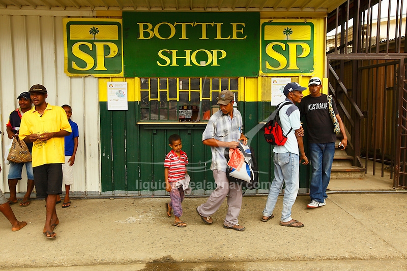 "Liquor store at Alotau. Alotau is the capital of Milne Bay Province, a province of Papua New Guinea..The town is located within the area in which the invading Japanese army suffered their first land defeat in the Pacific War in 1942, before the Kokoda Track battle. A memorial park at the old battle site commemorates the event..Alotau became the provincial capital in 1969 after it was shifted from Samarai..Alotau is the gateway to the Milne Bay Province which contains some of the most remote island communities in the world. Renowned for its friendly people and amazing tropical islands, it is a very well kept secret and sees very few tourists each year. The whole of Milne bay offers some of the worlds best scuba diving and coral reef experiences..Alotau itself is a busy regional ""Outpost""-like town. Most facilities are available here although it can be sporadic at times.."