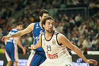Real Madrid´s Sergio Llull and Anadolu Efes´s Dogus Balbay during 2014-15 Euroleague Basketball match between Real Madrid and Anadolu Efes at Palacio de los Deportes stadium in Madrid, Spain. December 18, 2014. (ALTERPHOTOS/Luis Fernandez) /NortePhoto /NortePhoto.com