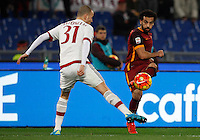 Calcio, Serie A: Roma vs Milan. Roma, stadio Olimpico, 9 gennaio 2016.<br /> Roma's Mohamed Salah, right, is challenged by AC Milan's Luca Antonelli during the Italian Serie A football match between Roma and Milan at Rome's Olympic stadium, 9 January 2016.<br /> UPDATE IMAGES PRESS/Riccardo De Luca