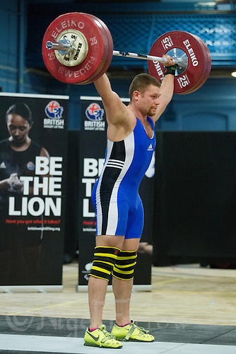 23 FEB 2014 - SMETHWICK, GBR - Peter Barnett attempts to hold a lift during the men's 105kg category round at the 2014 English Weightlifting Championships at the Harry Mitchell Leisure Centre in Smethwick, Great Britain. Barnett's final total of 310kg makes him eligible for selection for the England weightlifting team for the 2014 Commonwealth Games (PHOTO COPYRIGHT © 2014 NIGEL FARROW, ALL RIGHTS RESERVED)