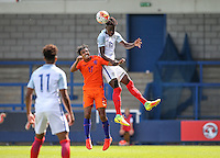 Trevoh Chalabah of England beats Mitchell Van Rooijen of Holland in the air during the International match between England U19 and Netherlands U19 at New Bucks Head, Telford, England on 1 September 2016. Photo by Andy Rowland.