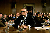 """In this undated file photo circa 1973, former deputy attorney general William D. Ruckelshaus, who resigned his position to avoid carrying out former United States President Richard M. Nixon's illegal order to fire the Watergate  special independent prosecutor Archibald Cox on the evening of Saturday, October 20, 1973 in the constitutional crisis known as the """"Saturday Night Massacre"""" testifies before a US Senate committee.  Ruckelshaus passed away on Wednesday, November 27, 2019 at 87 years of age.<br /> Credit: Arnie Sachs / CNP"""