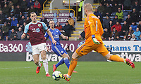 Leicester City's Kasper Schmeichel clears under pressure from Burnley's Chris Wood<br /> <br /> Photographer Rich Linley/CameraSport<br /> <br /> The Premier League - Burnley v Leicester City - Saturday 16th March 2019 - Turf Moor - Burnley<br /> <br /> World Copyright © 2019 CameraSport. All rights reserved. 43 Linden Ave. Countesthorpe. Leicester. England. LE8 5PG - Tel: +44 (0) 116 277 4147 - admin@camerasport.com - www.camerasport.com