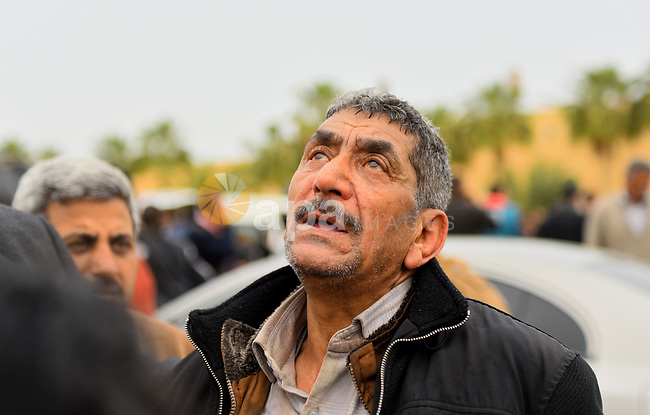 An Egyptian Christian man mourns for the victims of the blast at the Coptic Christian Saint Mark's church in Alexandria the previous day during a funeral procession at the Monastery of Marmina in the city of Borg El-Arab, east of Alexandria on April 10, 2017. Egypt prepared to impose a state of emergency after jihadist bombings killed dozens at two churches in the deadliest attacks in recent memory on the country's Coptic Christian minority. Photo by Amr Sayed