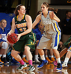 BROOKINGS, SD - FEBRUARY 22:  Bree Whatman #22 from North Dakota State University looks for a teammate while being guarded by Tara Heiser #12 from South Dakota State University in the first half of their game Saturday afternoon at Frost Arena in Brookings.  (Photo by Dave Eggen/Inertia)