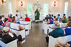 August 19, 2017; Rev. David Eliaona, C.S.C., celebrates mass with the pilgrims at in the Battlefield Chapel, Tippecanoe Battlefield Park.  On day 6, the pilgrims walked 15.6 miles on the ND Trail from Lafayette to Battle Ground, Indiana. As part of the University's 175th anniversary celebration, the Notre Dame Trail will commemorate Father Sorin and the Holy Cross Brothers' journey. A small group of pilgrims will make the entire 300+ mile journey from Vincennes to Notre Dame over  two weeks. (Photo by Barbara Johnston/University of Notre Dame)