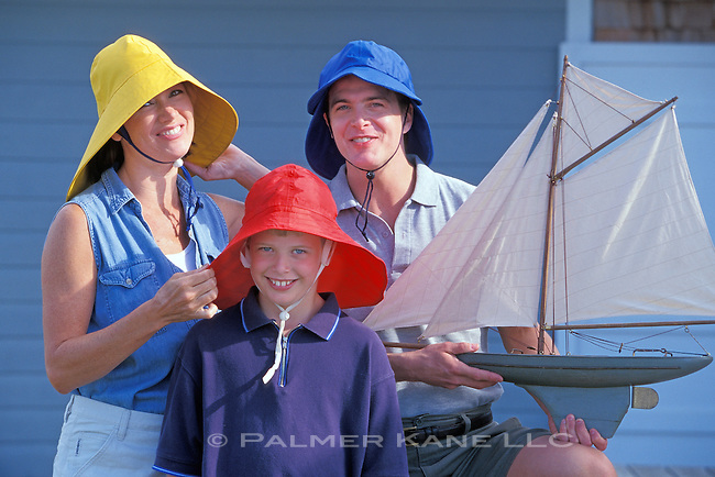 Silly family portrait with mariner's hats and toy boat