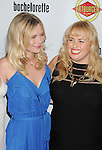 HOLLYWOOD, CA - AUGUST 23: Kirsten Dunst and Rebel Wilson arrive at the Los Angeles premiere of 'Bachelorette' at the Arclight Hollywood on August 23, 2012 in Hollywood, California.