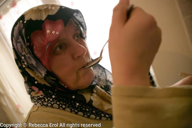 Turkish woman tastes her soup in Istanbul, Turkey