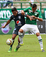 CALI -COLOMBIA-17-04-2016. Christian Rivera (Der) del Deportivo Cali disputa el balón con David Silva (Izq) de Millonarios durante partido por la fecha 13 de la Liga Águila I 2016 jugado en el estadio Palmaseca de Cali./ Christian Rivera (R) player of Deportivo Cali fights for the ball with David Silva (L) player of Millonarios during match for the date 13 of the Aguila League I 2016 played at Palmaseca stadium in Cali. Photo: VizzorImage/Juan C Quintero