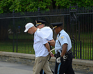 June 25, 2011 (Washington, DC) Philip Pannell was the first of twelve people to be arrested outside of the White House protesting what they consider unfair treatment of District of Columbia residents. The House Appropriations Committee passed a bill that would prohibit DC from using local tax dollars to provide reproductive healthcare for low-income women.  Many residents feel that Congress too often interferes in local government affairs.  The arrests come just over two months after Mayor Vincent Gray and several city council members were arrested in front of the Dirksen Senate Office Building on April 11, 2011, during a protest opposing congressional oversight of the city's budget. (Photo: Don Baxter/Media Images International)