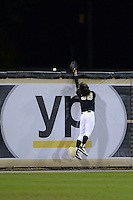 Central Florida Knights outfielder Bret Gordon (36) can not catch the home run off the bat of Dan Swain (not pictured) during the season opening game against the Siena Saints at Jay Bergman Field on February 14, 2014 in Orlando, Florida.  UCF defeated Siena 8-1.  (Mike Janes/Four Seam Images)