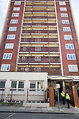 Police guard Alexandra Court, a hostel used by Hackney Council as temporary accommodation for homeless families.