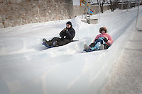 Dominick Miserandino, left, rides an ice slide with his wife Margherita and his daughter Caterina at the Quebec Winter Carnival (Carnaval de Quebec) in Quebec city, February 3, 2010. With close to one million participants, it has grown to become the third largest winter celebration in the world.