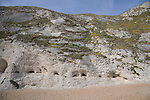 Fault guided caves in base of chalk cliffs near Durdle Door, Jurassic coast, Dorset, England.