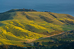 Sunset light on rolling green coastal hills in Spring above the Pacific Ocean, near Santa Barbara, California