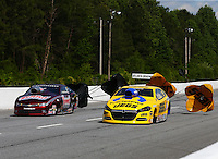 May 19, 2014; Commerce, GA, USA; NHRA pro stock driver Jeg Coughlin Jr (right) defeats Greg Anderson in the final round of the Southern Nationals at Atlanta Dragway. Mandatory Credit: Mark J. Rebilas-USA TODAY Sports