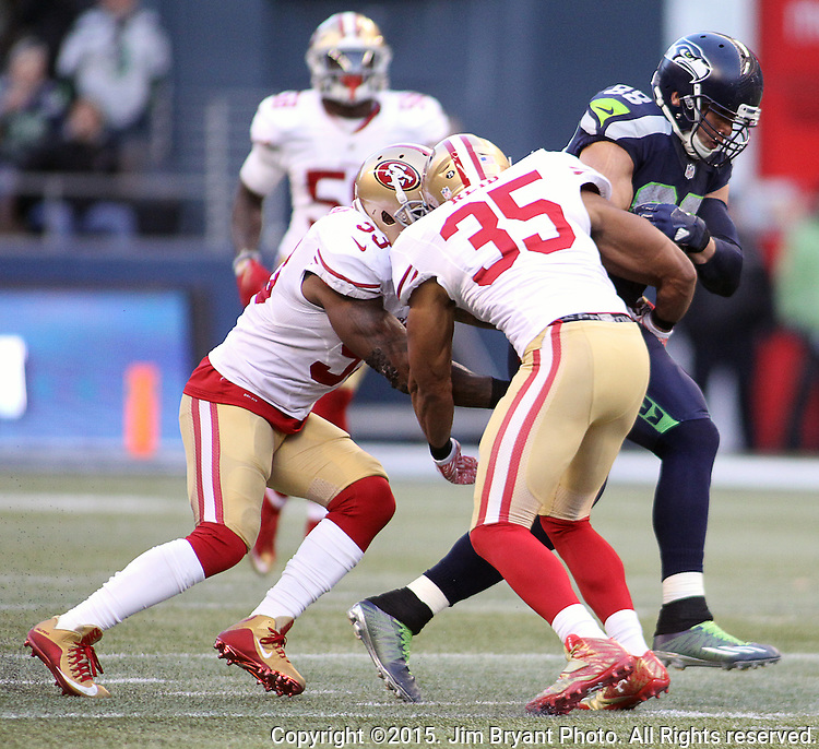 Seattle Seahawks tight end Jimmy Graham (88) picks up first down yardage agains the San Francisco 49ers linebacker NaVorro Bowman (53) and safety Eric Reid (35)at CenturyLink Field in Seattle, Washington on November 22, 2015.  The Seahawks beat the 49ers 29-13.   ©2015. Jim Bryant Photo. All RIghts Reserved.