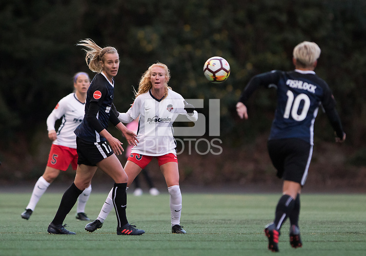 Seattle, WA - Saturday March 24, 2018: Beverly Yanez, Tori Huster, Jessica Fishlock during a regular season National Women's Soccer League (NWSL) match between the Seattle Reign FC and the Washington Spirit at the UW Medicine Pitch at Memorial Stadium. The Seattle Reign FC won 2-1.