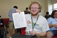 OrigamiUSA 2016 Convention at St. John's University, Queens, New York, USA. Geof Thomas, Massachusetts  folder in the Airliner class taught by Andrew Mao with his finished model and a some notes he has taken.