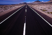 Pan American highway goes through the Atacama desert, the driest place on earth where parts of the desert go for more than a century without recordable precipitation. The highway is a network of roads nearly 48,000 kilometres (29,800 miles--the Southern part begins in Laredo, Texas and runs to Argentina.