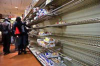 """Bare shelves because of Hurricane Sandy at a supermarket in New York on Sunday, October 28, 2012. In advance of the arrival of Hurricane Sandy New York will down the subways at 7 PM on Sunday and evacuate low lying """"Zone A"""" areas including Battery Park City. In addition the schools will be closed on Monday. (© Richard B. Levine)"""