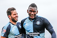 Aaron Pierre of Wycombe Wanderers & Sam Wood (left) of Wycombe Wanderers during the Sky Bet League 2 match between Dagenham and Redbridge and Wycombe Wanderers at the London Borough of Barking and Dagenham Stadium, London, England on 28 March 2015. Photo by Andy Rowland.
