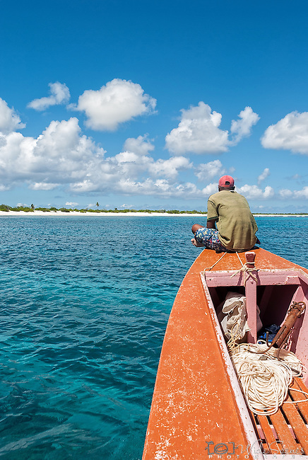 Cruising off the coast in a traditional boat on the island of Kiritimati in Kiribati