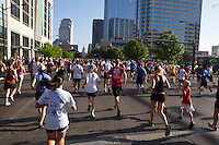 Thousands of runners trek through downtown Austin on their way to the finish line during an annual 10K race