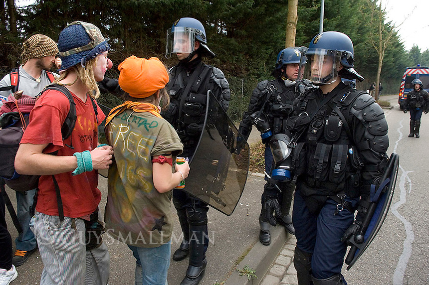 Fighting between Police and Anarchists outside the NATO summit. French riot Police fight protesters near the Ganzau camp in Strasbourg, France.
