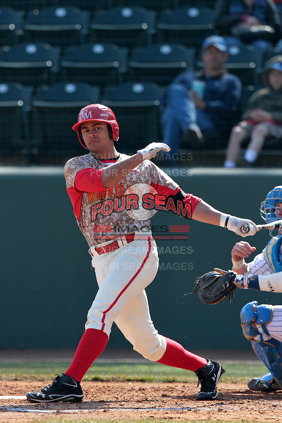 K.J. Hockaday #8 of the Maryland Terrapins bats against the UCLA Bruins at Jackie Robinson Stadium on February 19, 2012 in Los Angeles,California. Maryland defeated UCLA 5-1.(Larry Goren/Four Seam Images)