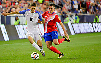 Harrison, N.J. - Friday September 01, 2017:   Christian Pulisic, Bryan Oviedo during a 2017 FIFA World Cup Qualifying (WCQ) round match between the men's national teams of the United States (USA) and Costa Rica (CRC) at Red Bull Arena.