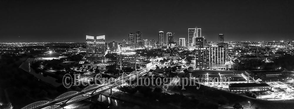 Another capture of this aerial panorama image in black and white of the Fort Worth skyline with the Seventh Street bridge as it crosses the Trinity River in downtown after dark. The 7th street bridge was lighted up nicely so it really popped in this image of the cityscape in black and white. Fort Worth is the fifth largest city in Texas. Ft Worth is located in central north part of Texas and the county seat is Tarrant County. The latest census is that the population for Fort Worth is estimates, at around 854,113. The city is the second-largest in the Dallas–Fort Worth–Arlington metropolitan area or the DFW Metro.