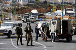 Israeli soldiers gather at the scene of an attempted stabbing attack near the Jewish settlement of Kiryat Arba in Hebron, in the occupied West Bank, on November 5, 2018. Photo by Wisam Hashlamoun