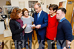 Rachel Fitzgerald, manager of the Down Syndrome Ireland shop in Tralee hands Fianna Fail's Micheál Martin their Q and A Election document on his visit to the shop on Monday with Cllr Norma Foley.<br /> In the photo l to r: Rachel Fitzgerald (Manager), Grace O'Donnell, Micheál Martin TD, Cllr Norma Foley and Conor Griffin