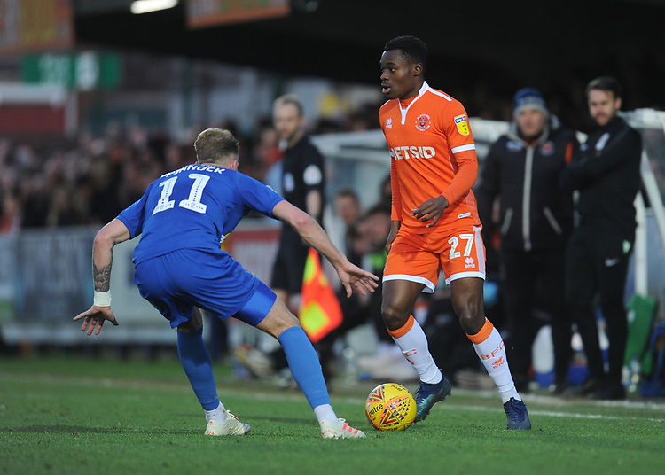 Blackpool's Marc Bola under pressure from AFC Wimbledon's Mitch Pinnock<br /> <br /> Photographer Kevin Barnes/CameraSport<br /> <br /> The EFL Sky Bet League One - AFC Wimbledon v Blackpool - Saturday 29th December 2018 - Kingsmeadow Stadium - London<br /> <br /> World Copyright © 2018 CameraSport. All rights reserved. 43 Linden Ave. Countesthorpe. Leicester. England. LE8 5PG - Tel: +44 (0) 116 277 4147 - admin@camerasport.com - www.camerasport.com