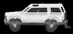 X-ray image of a sports utility vehicle (white on black) by Jim Wehtje, specialist in x-ray art and design images.