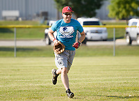 NWA Democrat-Gazette/CHARLIE KAIJO Matt Mika runs the outfield during the Tyson Chicken annual softball tournament, Friday, August 3, 2018 at the Rogers Regional Sports Park in Rogers. <br />