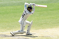 29th December 2019; Melbourne Cricket Ground, Melbourne, Victoria, Australia; International Test Cricket, Australia versus New Zealand, Test 2, Day 4; Tom Blundell of New Zealand hits the ball through the covers - Editorial Use