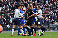 Son Heung-Min of Tottenham Hotspur is shown a yellow card by referee Michael Oliver during Tottenham Hotspur vs Leicester City, Premier League Football at Wembley Stadium on 10th February 2019