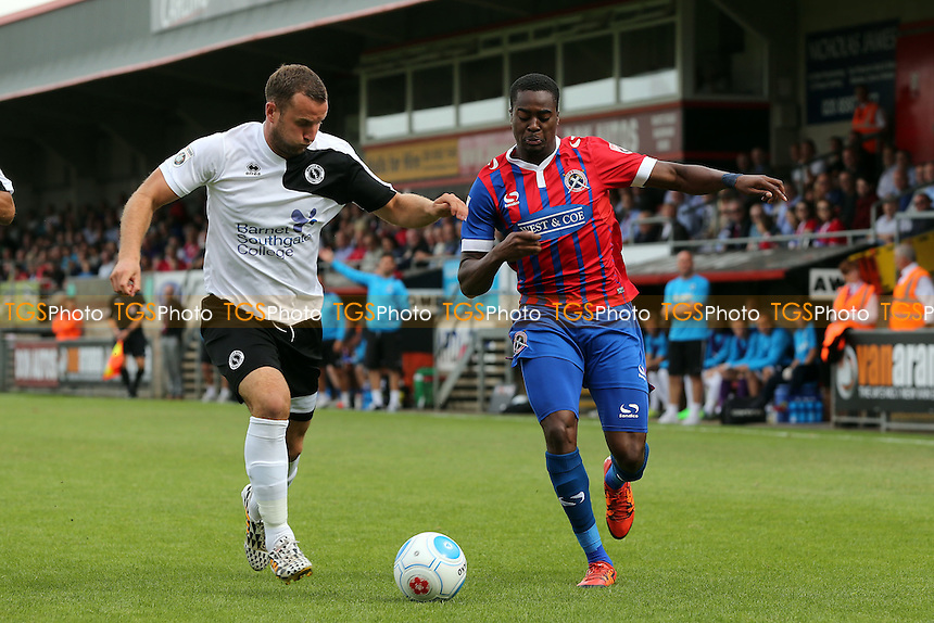 Danny Woodards of Boreham Wood and Fejiri Okenabirhie of Dagenham during Dagenham and Redbridge vs Boreham Wood, Vanarama National League Football at the Chigwell Construction Stadium on 3rd September 2016