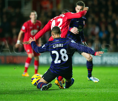01.01.2013 Southampton, England.  Arsenal's Kieran Gibbs tackle on Southampton's Jason Puncheon during the Premier League game between Southampton and Arsenal at St Mary's Stadium.