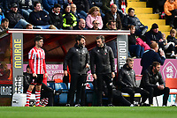 Lincoln City's Tom Pett, left, prepares to come on as a substitute as Lincoln City manager Danny Cowley, centre, talks to Lincoln City's assistant manager Nicky Cowley<br /> <br /> Photographer Chris Vaughan/CameraSport<br /> <br /> The EFL Sky Bet League Two - Lincoln City v Crewe Alexandra - Saturday 6th October 2018 - Sincil Bank - Lincoln<br /> <br /> World Copyright &copy; 2018 CameraSport. All rights reserved. 43 Linden Ave. Countesthorpe. Leicester. England. LE8 5PG - Tel: +44 (0) 116 277 4147 - admin@camerasport.com - www.camerasport.com