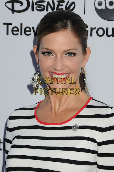 Tricia Helfer.Disney Media Networks International Upfronts 2013 held at Walt Disney Studios, Burbank, California, USA..May 19th, 2013.headshot portrait white stripe pink trim smiling dangling earrings  black.CAP/ADM/BP.©Byron Purvis/AdMedia/Capital Pictures