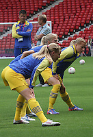 Women's Olympic Football match France v Sweden on 3.8.12...Swedish players stretching before the Women's Olympic Football match between France v Sweden at Hampden Park, Glasgow...............